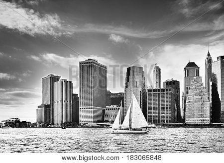 Sailing boat against a Manhattan skyline - HDR image.