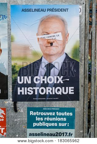 STRASBOURG FRANCE - APR 26 2017: Official campaign posters of Francois Asselineau political party leader of Union populaire republicaine (UPR) vandalized on the first round of 2017 French presidential election