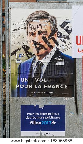 STRASBOURG FRANCE - APR 26 2017: Official campaign posters of FranCois Fillon political party leader of Les Republicains (LR) vandalized on the first round of 2017 French presidential election