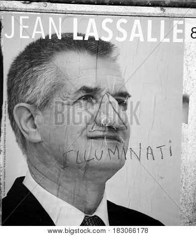 STRASBOURG FRANCE - APR 26 2017: Official campaign posters of Jean Lassalle political party leader of Resistons vandalized on the first round of 2017 French presidential election