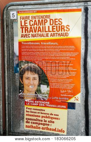 STRASBOURG FRANCE - APR 23 2017: Official campaign posters of Nathalie Arthaudpolitical party leader of Lutte ouvriere (LO) vandalized on the first round of 2017 French presidential election