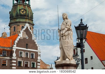 On The Town Hall Square: Sculpture Of Saint Roland And Saint Peters Church In Old City Riga, Latvia.