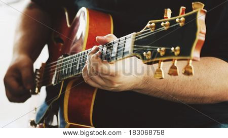 Artistic Close-up of Acoustic Guitar Being Played