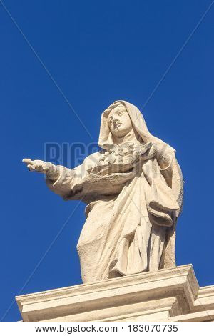 Statue. Famous colonnade of St. Peter's Basilica in Vatican, Rome, Italy