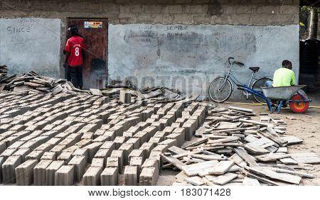 Zanzibar, Tanzania - July 14, 2016: Local folks resting during their break from working and making bricks, Zanzibar, Tanzania