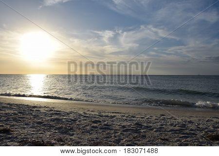 Sun over Ocean on Sand Key Beach, FL