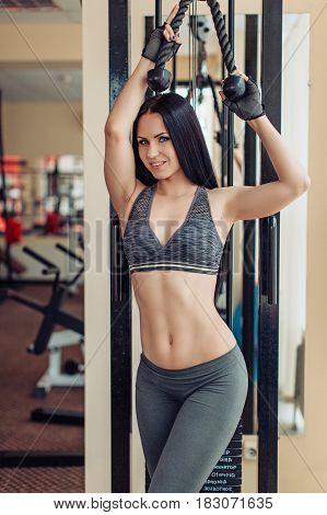 Sexy brunette woman on sport gym club