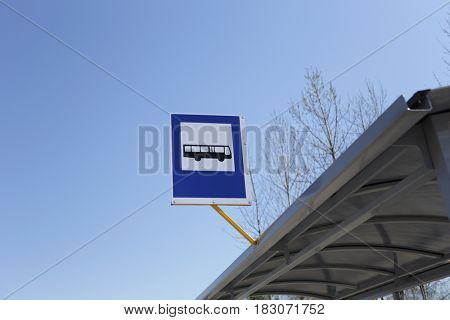 Bus stop traffic sign on the roof of busstop.