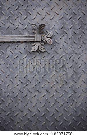 Old iron doors close up.