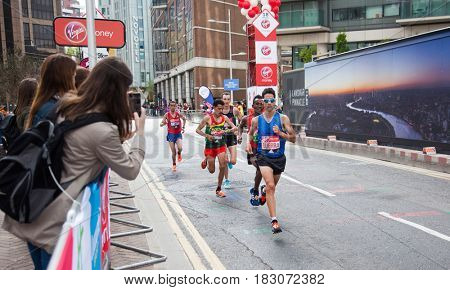 LONDON - APRIL 23, 2017: Athletes run in the Virgin Money London Marathon on April 23, 2017 in Isle of Dogs.