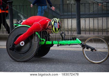 LONDON - APRIL 23, 2017: Wheelchair racer in the Virgin Money London Marathon on April 23, 2017 in Isle of Dogs.