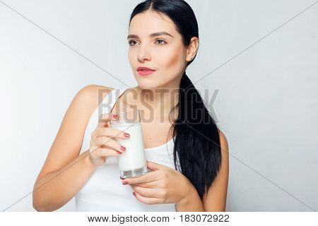 people food beauty lifestyle fashion and sensitive concept - Milk - Woman drinking milk happy and smiling beautiful young woman enjoying a glass milk