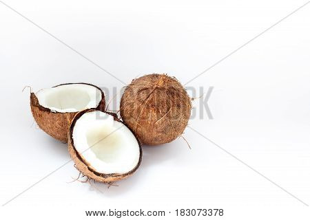 Ripe Coconuts And Half Coconut On White Background
