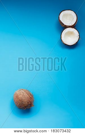 Ripe Coconuts And Half Coconut On Blue Background