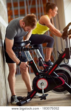 Male adapt exercise bike in gym