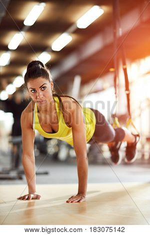 Young woman on hard training in gym