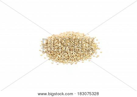 Heap of healthy quinoa seeds isolated on white