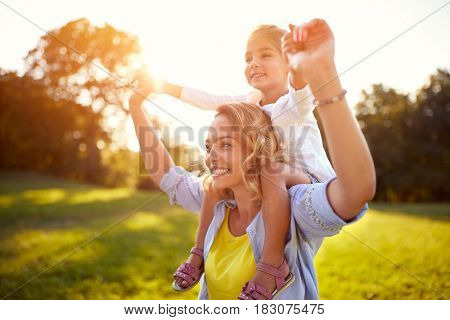 Happy mother and daughter together in park