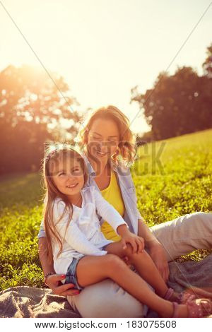 Mother and young daughter on picnic outdoor