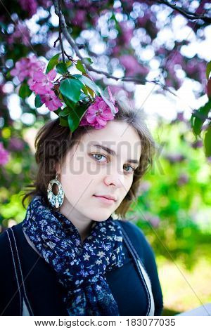 Portrait Of A Young Beautiful Girl In A Flowering Tree. Beauty Of Springtime Without Allergy
