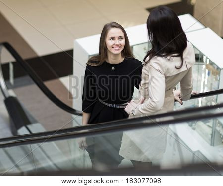 Manager and client standing on the stairs in the lobby of the office. The photo has an empty space for your text