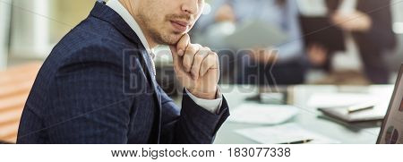 closeup of a senior Manager at the workplace on the background of business team