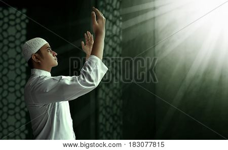Muslim man praying to God in mosque
