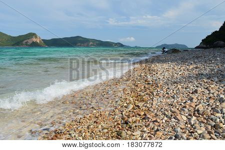 Scenic view of wave on stone beach in evening day, kohkham underwater park, chonburi province, Thailand.