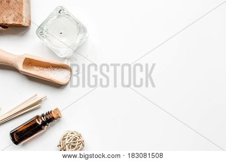 bathroom salt and aroma oil for spa set on white background top view mock-up