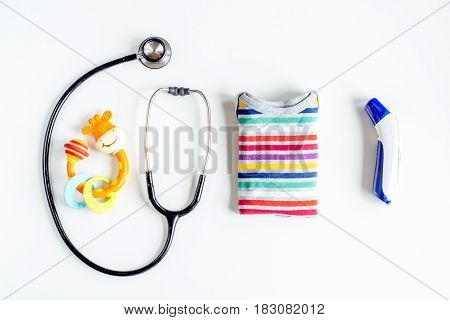 children's doctor work with stethoscope and toys on white desk background top view mock-up