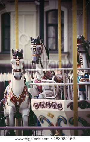 Vintage film look close-up of carousel horse