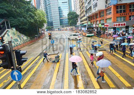 HONG KONG - CIRCA NOVEMBER, 2016: people walking crossing road in Hong Kong.