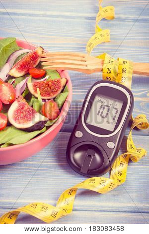 Vintage Photo, Fruit And Vegetable Salad And Glucometer With Tape Measure, Concept Of Diabetes, Slim