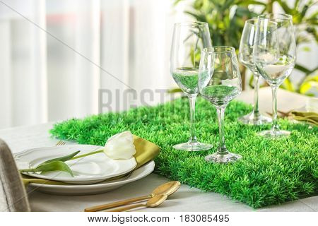 Table with beautiful setting in restaurant, closeup