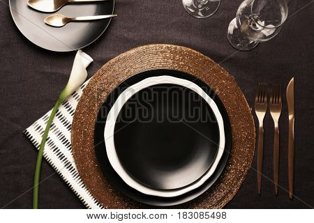 Table setting with floral decor on tablecloth