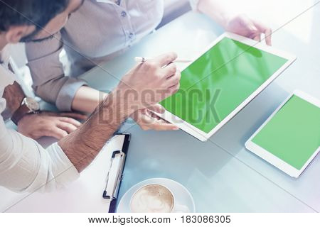 Man and woman discussing a project showing it with tablet pc. Clipping path included.