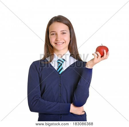 Cute schoolgirl with apple on white background