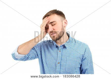 Young man suffering from headache on white background
