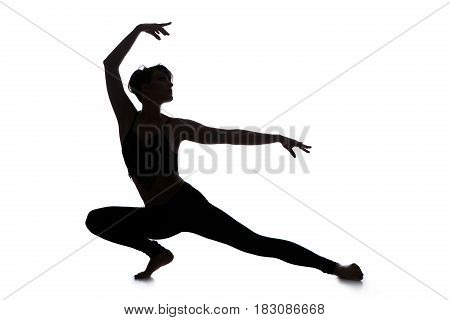 Silhouette of young woman dancer. Studio shot isolated on white background.