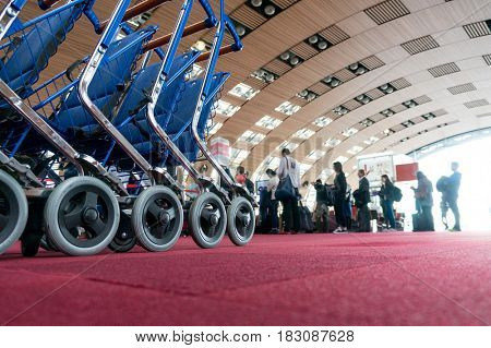 luggage carts at modern airport.