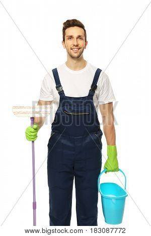 Young window cleaner with special supplies on white background