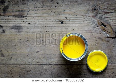 building decoration instruments with paint in builder work on wooden background top view mock up