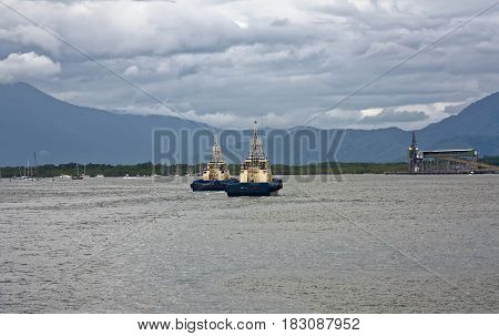 two tug boats coming into Cairns Port
