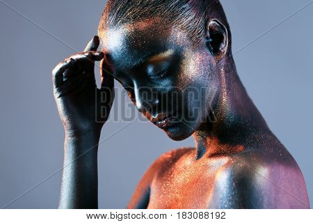 Young woman with creative body art on color background