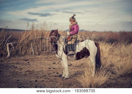 Kazakh Eagle Hunters In Traditionally Wearing Typical Mongolian Dress Culture Of Mongolia She Rider