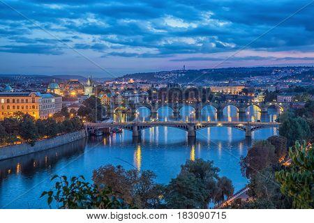 View on bridges across Vltava river at dusk from Letenske sady in Parague Czech republic