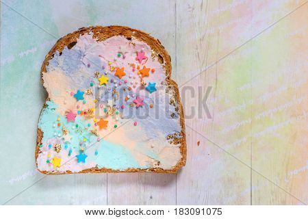 Unicorn food toasted bread with colorfur cream cheese with stars and gold