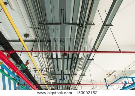 Industrial Electrical, Air Conditioning, Water, Sewage Service Pipes On Ceiling