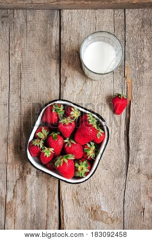 Heap Of Fresh Ripe Raw Strawberries In A Bowl And Glass Of Milk On A Wooden Background. Rustic Style