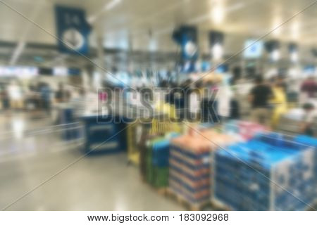 Abstract Blur background of moden shopping mall checkout counter with people queing to pay products goods items skus basket commerce money for shopping sale discount communication concept design